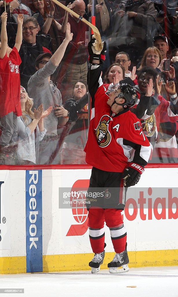 Kyle Turris of the Ottawa Senators gives a fan his stick after being named the second star of the game and scoring the overtime goal against the...