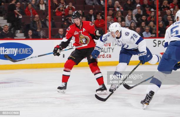 Kyle Turris of the Ottawa Senators gloves the puck down as he fends off Byron Froese of the Tampa Bay Lightning at Canadian Tire Centre on March 14...