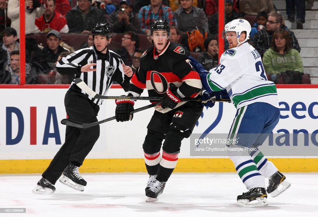 <a gi-track='captionPersonalityLinkClicked' href=/galleries/search?phrase=Kyle+Turris&family=editorial&specificpeople=4251834 ng-click='$event.stopPropagation()'>Kyle Turris</a> #7 of the Ottawa Senators holds the stick of <a gi-track='captionPersonalityLinkClicked' href=/galleries/search?phrase=Henrik+Sedin&family=editorial&specificpeople=202574 ng-click='$event.stopPropagation()'>Henrik Sedin</a> #33 of the Vancouver Canucks during an NHL game at Canadian Tire Centre on November 28, 2013 in Ottawa, Ontario, Canada.