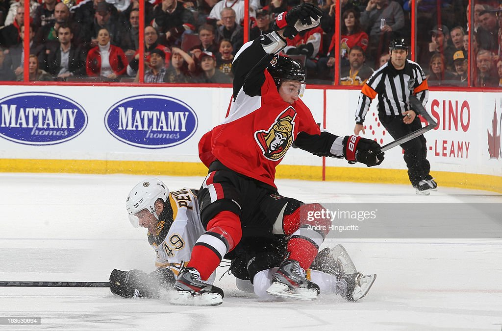 Kyle Turris #7 of the Ottawa Senators is upended by Rich Peverley #49 of the Boston Bruins on March 11, 2013 at Scotiabank Place in Ottawa, Ontario, Canada.