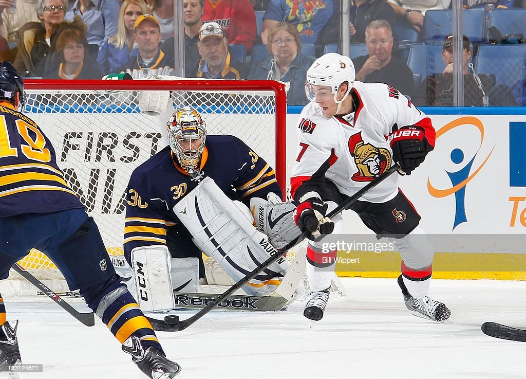 Kyle Turris #7 of the Ottawa Senators looks to deflect the puck in front of Ryan Miller #30 of the Buffalo Sabres on October 4, 2013 at the First Niagara Center in Buffalo, New York.