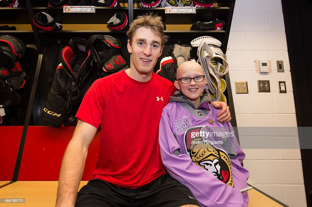 Kyle Turris of the Ottawa Senators poses for a photo in his stall after spending some time with a local girl battling cancer after a game against the...