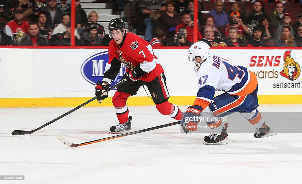 <a gi-track='captionPersonalityLinkClicked' href=/galleries/search?phrase=Kyle+Turris&family=editorial&specificpeople=4251834 ng-click='$event.stopPropagation()'>Kyle Turris</a> #7 of the Ottawa Senators positions himself for a shot against Andrew MacDonald #47 of the New York Islanders at Canadian Tire Centre on November 1, 2013 in Ottawa, Ontario, Canada.