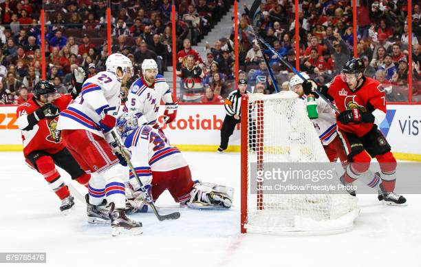 Kyle Turris of the Ottawa Senators scores the overtime goal as Ryan McDonagh Henrik Lundqvist and Dan Girardi of the New York Rangers in Game Five of...