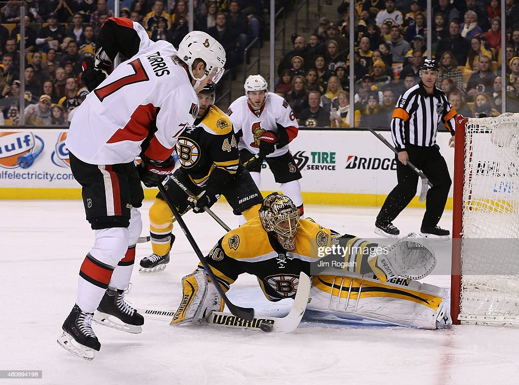 <a gi-track='captionPersonalityLinkClicked' href=/galleries/search?phrase=Kyle+Turris&family=editorial&specificpeople=4251834 ng-click='$event.stopPropagation()'>Kyle Turris</a> #7 of the Ottawa Senators shoots on net as <a gi-track='captionPersonalityLinkClicked' href=/galleries/search?phrase=Tuukka+Rask&family=editorial&specificpeople=716723 ng-click='$event.stopPropagation()'>Tuukka Rask</a> #40 of the Boston Bruins defends in the second period at TD Garden on January 3, 2015 in Boston, Massachusetts.
