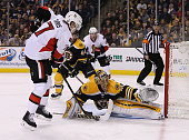 Kyle Turris of the Ottawa Senators shoots on net as Tuukka Rask of the Boston Bruins defends in the second period at TD Garden on January 3 2015 in...