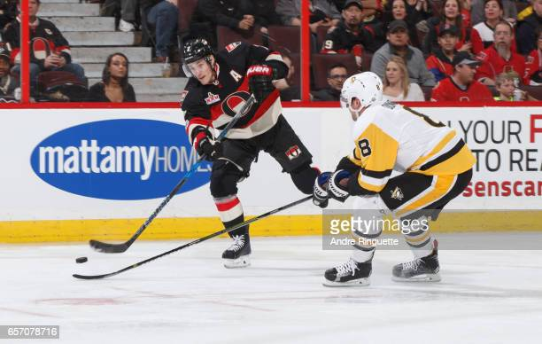 Kyle Turris of the Ottawa Senators shoots the puck against Brian Dumoulin of the Pittsburgh Penguins at Canadian Tire Centre on March 23 2017 in...