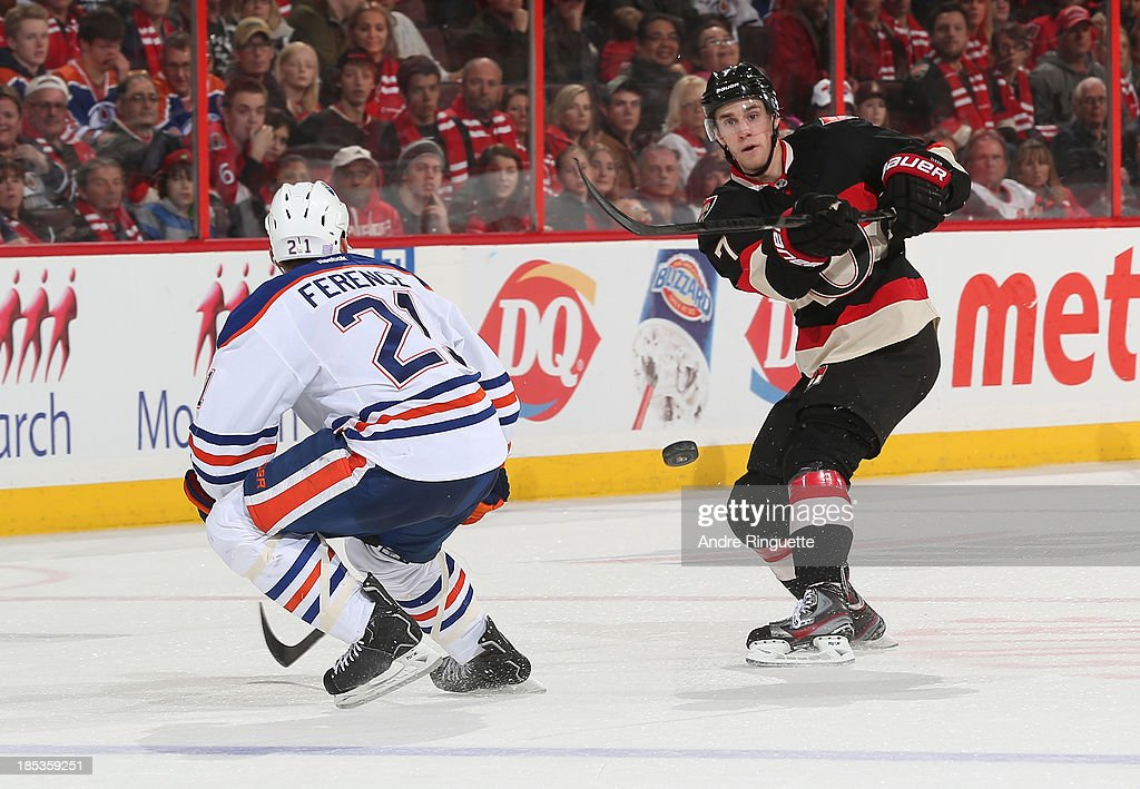 <a gi-track='captionPersonalityLinkClicked' href=/galleries/search?phrase=Kyle+Turris&family=editorial&specificpeople=4251834 ng-click='$event.stopPropagation()'>Kyle Turris</a> #7 of the Ottawa Senators shoots the puck into the offensive zone against <a gi-track='captionPersonalityLinkClicked' href=/galleries/search?phrase=Andrew+Ference&family=editorial&specificpeople=202264 ng-click='$event.stopPropagation()'>Andrew Ference</a> #21 of the Edmonton Oilers at Canadian Tire Centre on October 19, 2013 in Ottawa, Ontario, Canada.