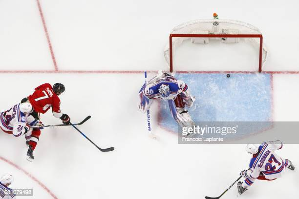 Kyle Turris of the Ottawa Senators shoots the puck past Henrik Lundqvist of the New York Rangers as Oscar Lindberg and Ryan McDonagh defends in Game...