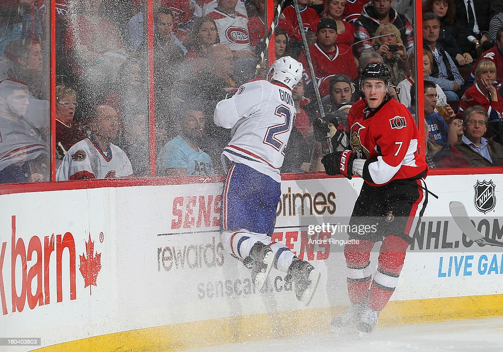 Kyle Turris of the Ottawa Senators sidesteps an attempted body check by Brian Gionta of the Montreal Canadiens on January 30 2013 at Scotiabank Place...