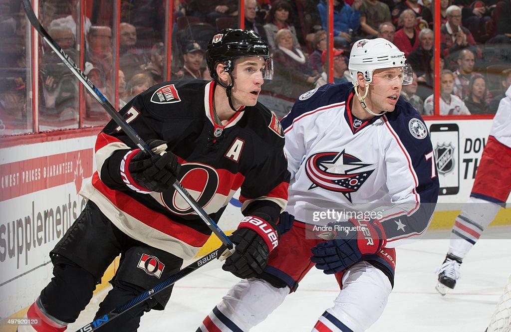 Kyle Turris of the Ottawa Senators skates against Jack Johnson of the Columbus Blue Jackets behind the net at Canadian Tire Centre on November 19...