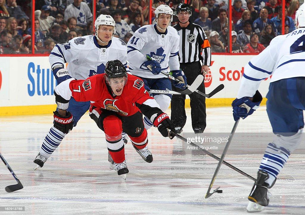 Kyle Turris #7 of the Ottawa Senators skates against Mikhail Grabovski #84 of the Toronto Maple Leafs on February 23, 2013 at Scotiabank Place in Ottawa, Ontario, Canada.