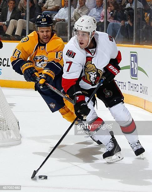 Kyle Turris of the Ottawa Senators skates against Olli Jokinen of the Nashville Predators at Bridgestone Arena on October 9 2014 in Nashville...