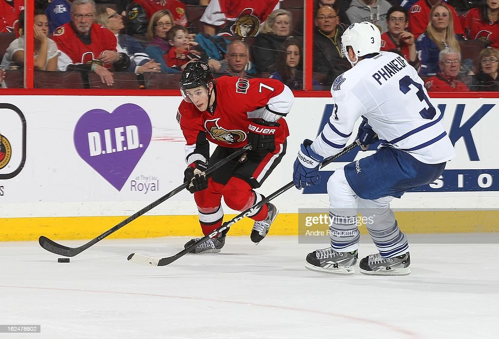 <a gi-track='captionPersonalityLinkClicked' href=/galleries/search?phrase=Kyle+Turris&family=editorial&specificpeople=4251834 ng-click='$event.stopPropagation()'>Kyle Turris</a> #7 of the Ottawa Senators skates by <a gi-track='captionPersonalityLinkClicked' href=/galleries/search?phrase=Dion+Phaneuf&family=editorial&specificpeople=545455 ng-click='$event.stopPropagation()'>Dion Phaneuf</a> #3 of the Toronto Maple Leafs with the puck on February 23, 2013 at Scotiabank Place in Ottawa, Ontario, Canada.