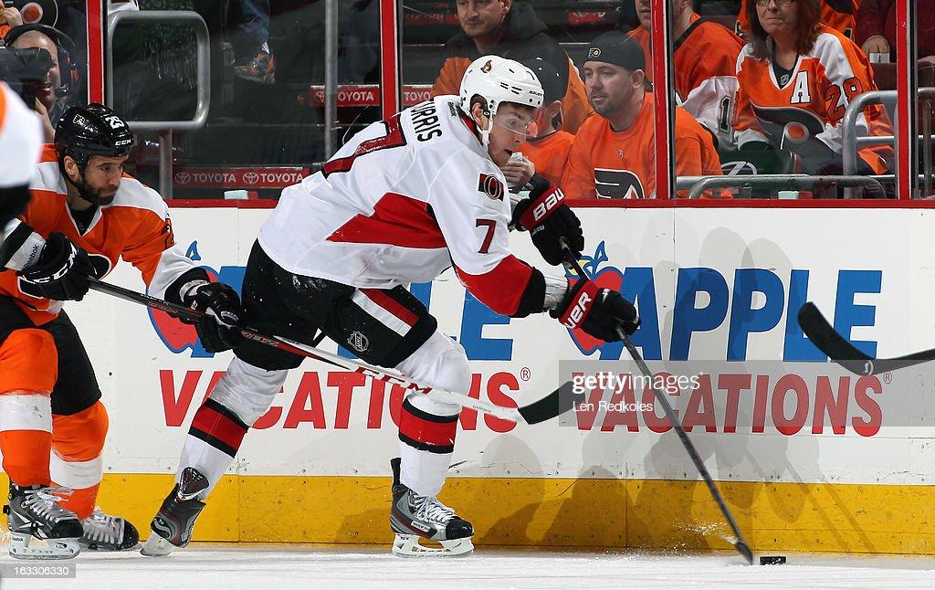 Kyle Turris #7 of the Ottawa Senators skates the puck against Max Talbot #25 of the Philadelphia Flyers on March 2, 2013 at the Wells Fargo Center in Philadelphia, Pennsylvania.