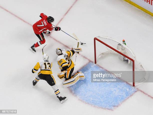 Kyle Turris of the Ottawa Senators skates the puck towards goaltender Matt Murray while Nick Bonino of the Pittsburgh Penguins tries to defend in...