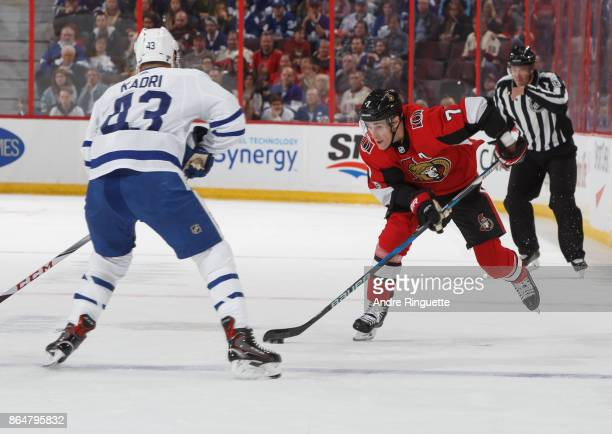 Kyle Turris of the Ottawa Senators skates up ice with the puck against Nazem Kadri of the Toronto Maple Leafs at Canadian Tire Centre on October 21...