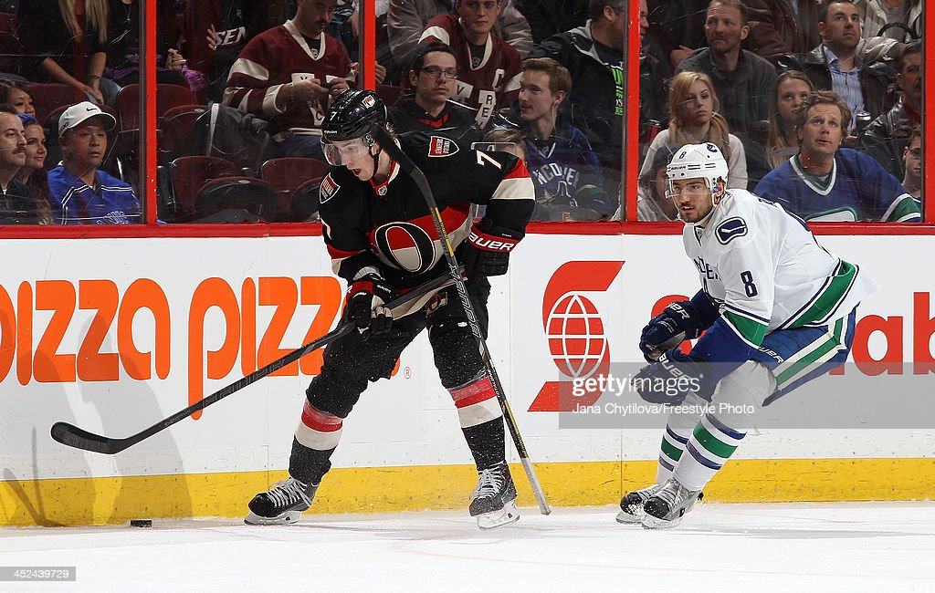 <a gi-track='captionPersonalityLinkClicked' href=/galleries/search?phrase=Kyle+Turris&family=editorial&specificpeople=4251834 ng-click='$event.stopPropagation()'>Kyle Turris</a> #7 of the Ottawa Senators skates with the puck as Chris Tanev #8 of the Vancouver Canucks loses his stick during an NHL game at Canadian Tire Centre on November 28, 2013 in Ottawa, Ontario, Canada.