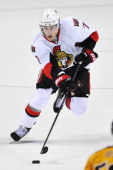 Kyle Turris of the Ottawa Senators skates with the puck during a NHL game against the Nashville Predators at Bridgestone Arena on January 11 2014 in...
