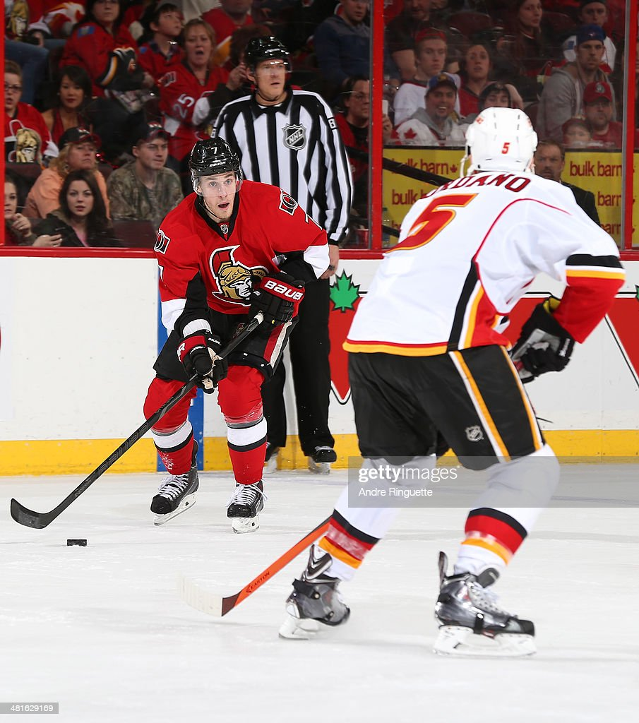 <a gi-track='captionPersonalityLinkClicked' href=/galleries/search?phrase=Kyle+Turris&family=editorial&specificpeople=4251834 ng-click='$event.stopPropagation()'>Kyle Turris</a> #7 of the Ottawa Senators stickhandles the puck against <a gi-track='captionPersonalityLinkClicked' href=/galleries/search?phrase=Mark+Giordano&family=editorial&specificpeople=696867 ng-click='$event.stopPropagation()'>Mark Giordano</a> #5 of the Calgary Flames at Canadian Tire Centre on March 30, 2014 in Ottawa, Ontario, Canada.