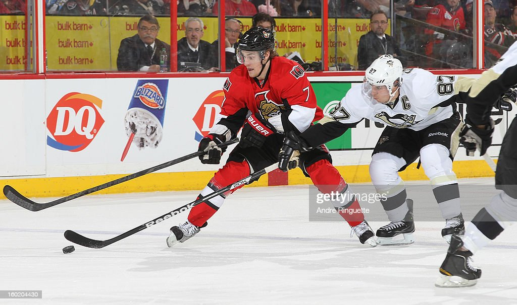 Kyle Turris #7 of the Ottawa Senators stickhandles the puck against Sidney Crosby #87 of the Pittsburgh Penguins on January 27, 2013 at Scotiabank Place in Ottawa, Ontario, Canada.