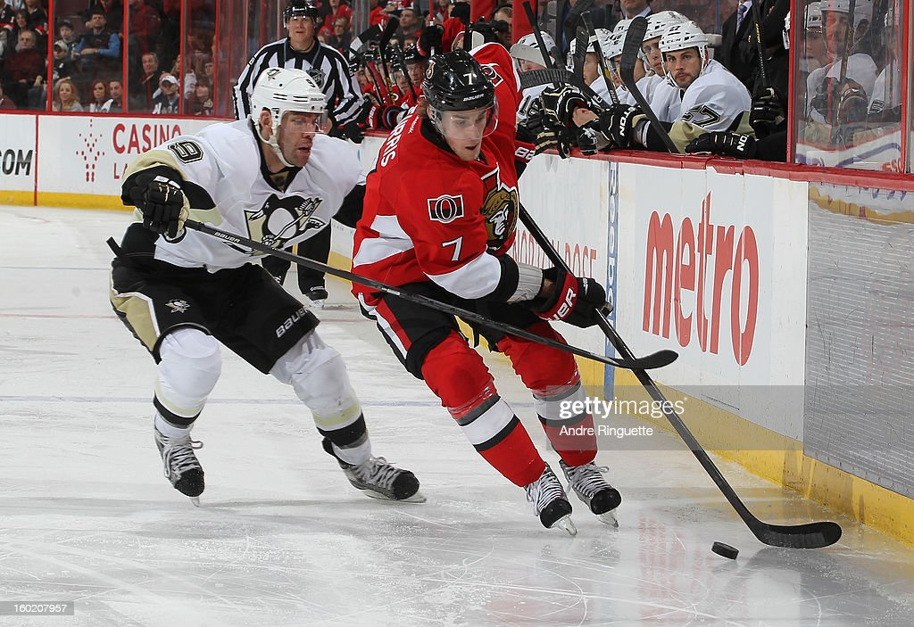 Kyle Turris #7 of the Ottawa Senators stickhandles the puck against Pascal Dupuis #9 of the Pittsburgh Penguins on January 27, 2013 at Scotiabank Place in Ottawa, Ontario, Canada.