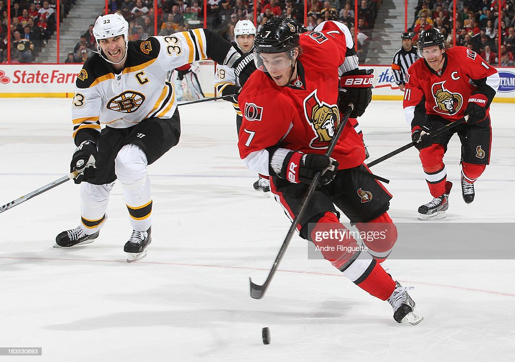 Kyle Turris #7 of the Ottawa Senators stickhandles the puck against Zdeno Chara #33 of the Boston Bruins on March 11, 2013 at Scotiabank Place in Ottawa, Ontario, Canada.