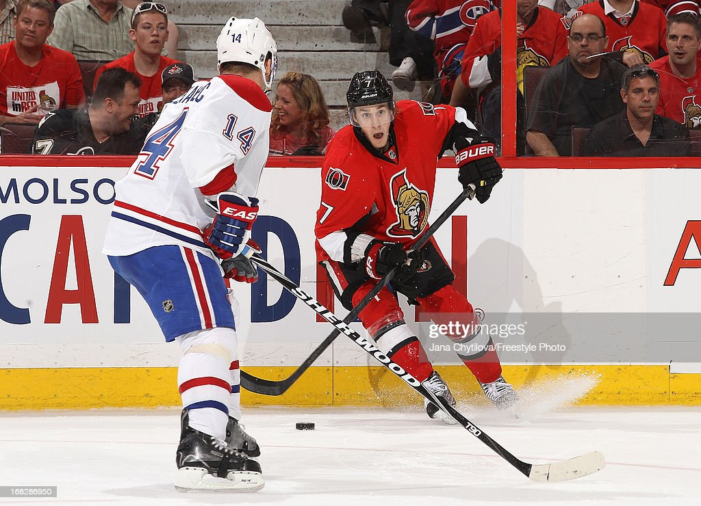 <a gi-track='captionPersonalityLinkClicked' href=/galleries/search?phrase=Kyle+Turris&family=editorial&specificpeople=4251834 ng-click='$event.stopPropagation()'>Kyle Turris</a> #7 of the Ottawa Senators stickhandles the puck against <a gi-track='captionPersonalityLinkClicked' href=/galleries/search?phrase=Tomas+Plekanec&family=editorial&specificpeople=620244 ng-click='$event.stopPropagation()'>Tomas Plekanec</a> #14 of the Montreal Canadiens in Game Four of the Eastern Conference Quarterfinals during the 2013 NHL Stanley Cup Playoffs, at Scotiabank Place, on May 7, 2013 in Ottawa, Ontario, Canada.