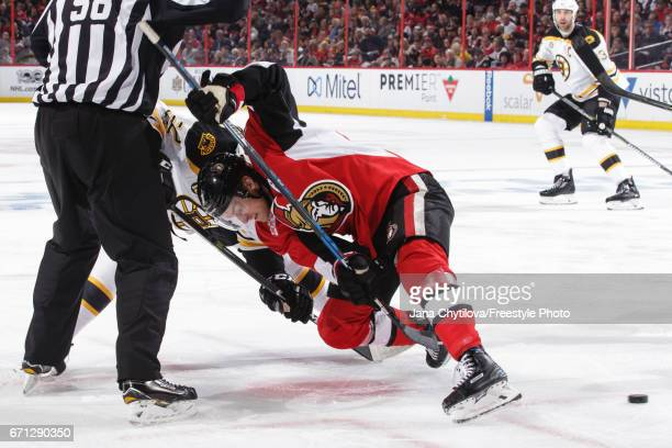 Kyle Turris of the Ottawa Senators takes a faceoff against Sean Kuraly of the Boston Bruins in the first period in Game Five of the Eastern...