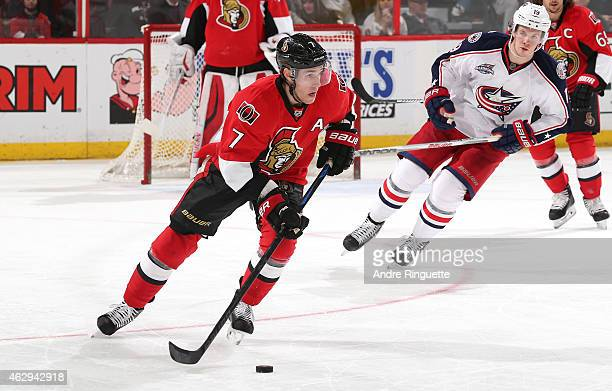 Kyle Turris of the Ottawa Senators turns up ice with the puck against Ryan Johansen of the Columbus Blue Jackets at Canadian Tire Centre on February...