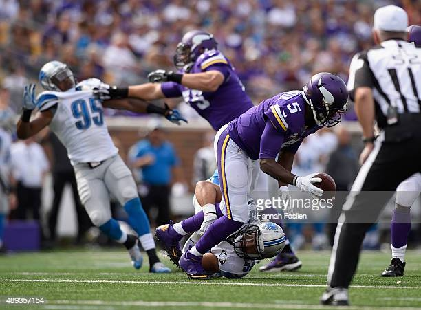 Kyle Van Noy of the Detroit Lions attempts to tackle Teddy Bridgewater of the Minnesota Vikings during the second quarter of the game on September 20...