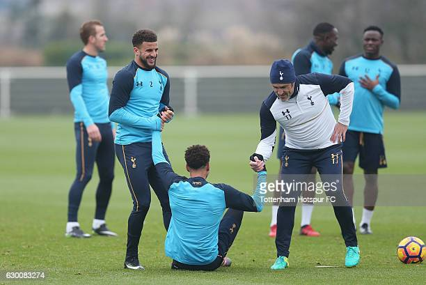 Kyle Walker and Dele Alli of Tottenham and goalkeeping coach Toni Jiménez during the Tottenham Hotspur training session at Tottenham Hotspur Training...