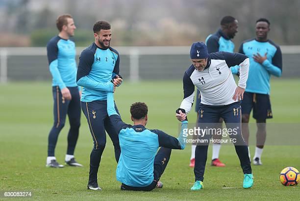 Kyle Walker and Dele Alli of Tottenham and goalkeeping coach Toni Jiménez during the Tottenham Hotspur training session at Tottenham Hotspur Training...