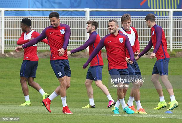 Kyle Walker and Jack Wilshere of England warm up during the training session ahead of the UEFA EURO 2016 at Stade des Bourgognes on June 10 2016 in...