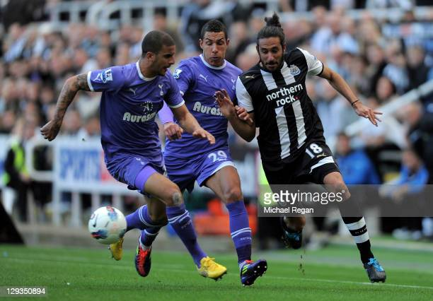 Kyle Walker and Jake Livermore of Tottenham Hotspur tussle for posession with Jonas Gutierrez of Newcastle United during the Barclays Premier League...