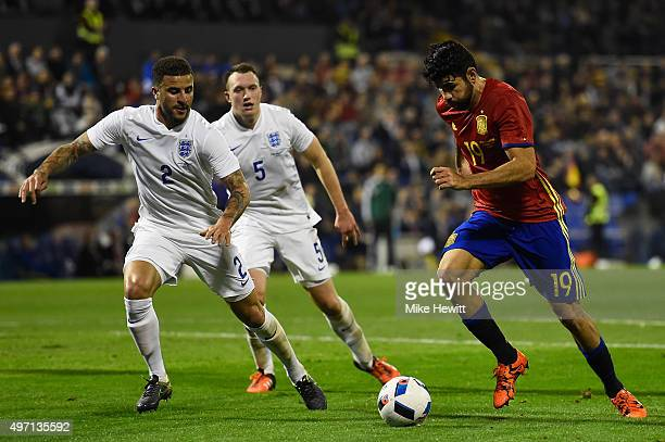 Kyle Walker and Phil Jones of England keep a close eye on Diego Costa of Spain during an International Friendly between Spain and England at the...