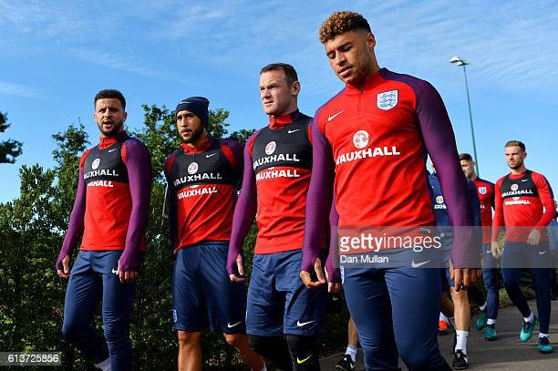 Kyle Walker Andros Townsend Wayne Rooney and Alex OxladeChamberlain walk out for an England training session at the Tottenham Hotspur training ground...
