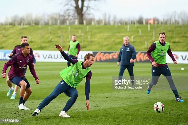 Kyle Walker Harry Kane and Phil Jones of England in action during an England training session at St Georges Park on March 24 2015 in BurtonuponTrent...