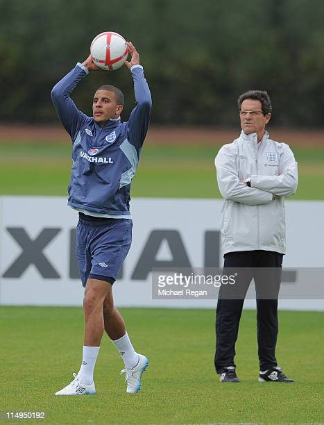 Kyle Walker in action as England manager Fabio Capello looks on during the England training session at London Colney on May 31 2011 in St Albans...