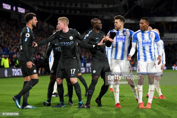 Kyle Walker Kevin De Bruyne and Eliaquim Mangala of Manchester City argue with Tommy Smith and Rajiv van La Parra of Huddersfield Town as Rajiv van...