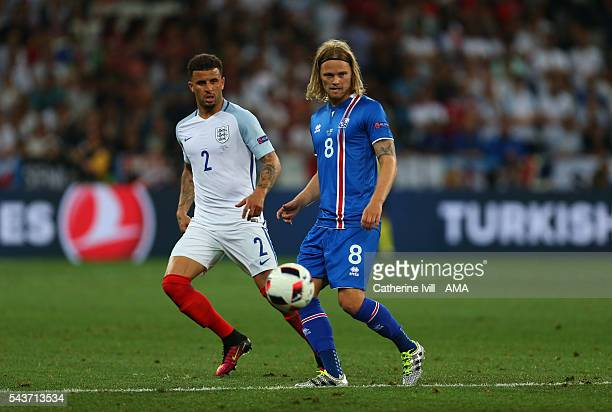 Kyle Walker of England and Birkir Bjarnason of Iceland during the UEFA EURO 2016 Round of 16 match between England and Iceland at Allianz Riviera...