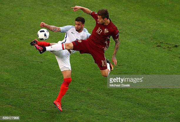Kyle Walker of England and Fedor Smolov of Russia compete for the ball during the UEFA EURO 2016 Group B match between England and Russia at Stade...