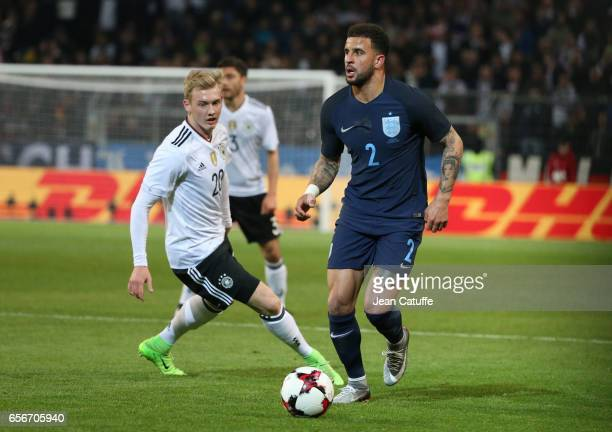 Kyle Walker of England and Julian Brandt of Germany in action during the international friendly match between Germany and England at Signal Iduna...
