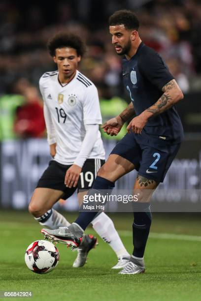 Kyle Walker of England and Leroy Sane of Germany battle for the ball during the international friendly match between Germany and England at Signal...