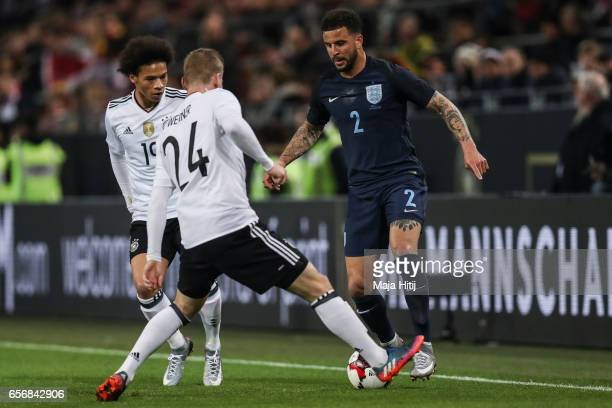 Kyle Walker of England and Timo Werner of Germany battle for the ball during the international friendly match between Germany and England at Signal...