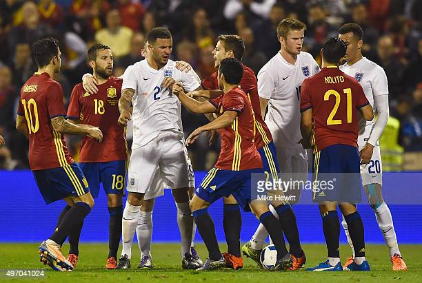 Kyle Walker of England argues with Pedro of Spain as players clash during the international friendly match between Spain and England at Jose Rico...