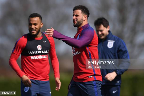 Kyle Walker of England gestures as teammate Ryan Bertrand looks on during the England training session at the Tottenham Hotspur Training Centre on...
