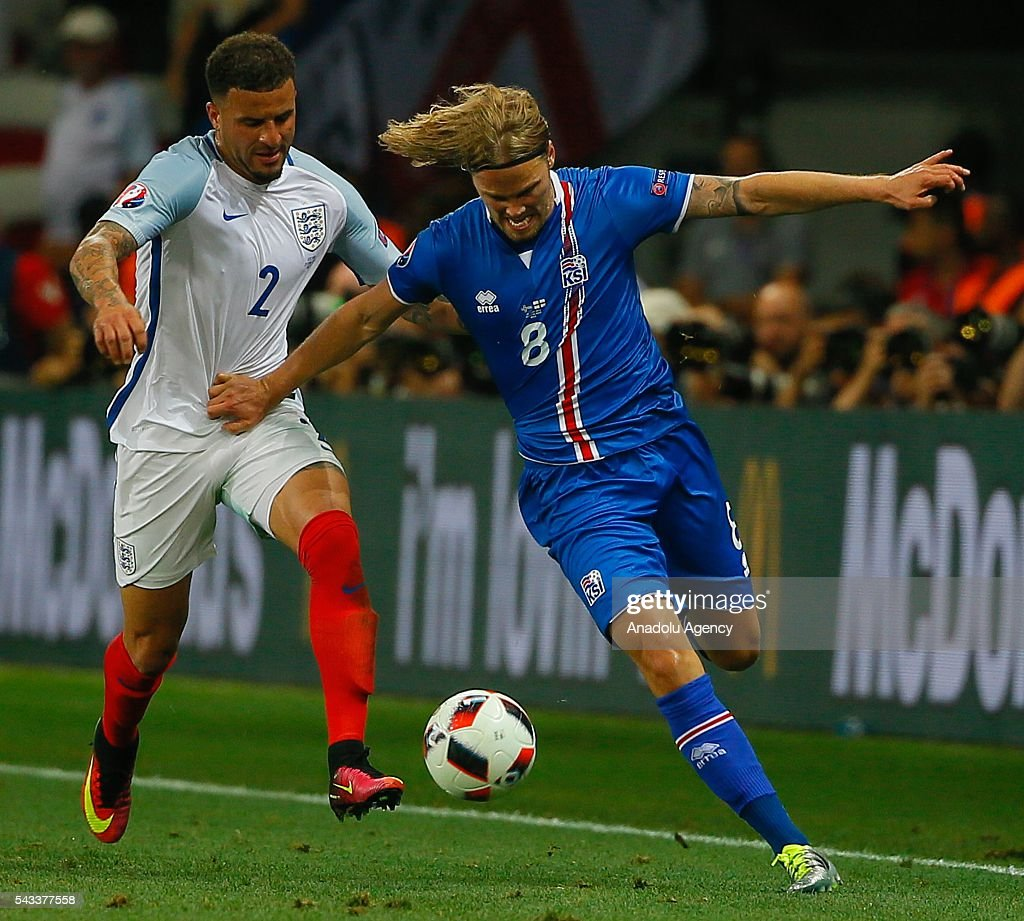 Kyle Walker (2) of England in action against Birkir Bjarnason (8) of Iceland during the UEFA Euro 2016 Round of 16 football match between Iceland and England at Stade de Nice in Nice, France on June 27, 2016.