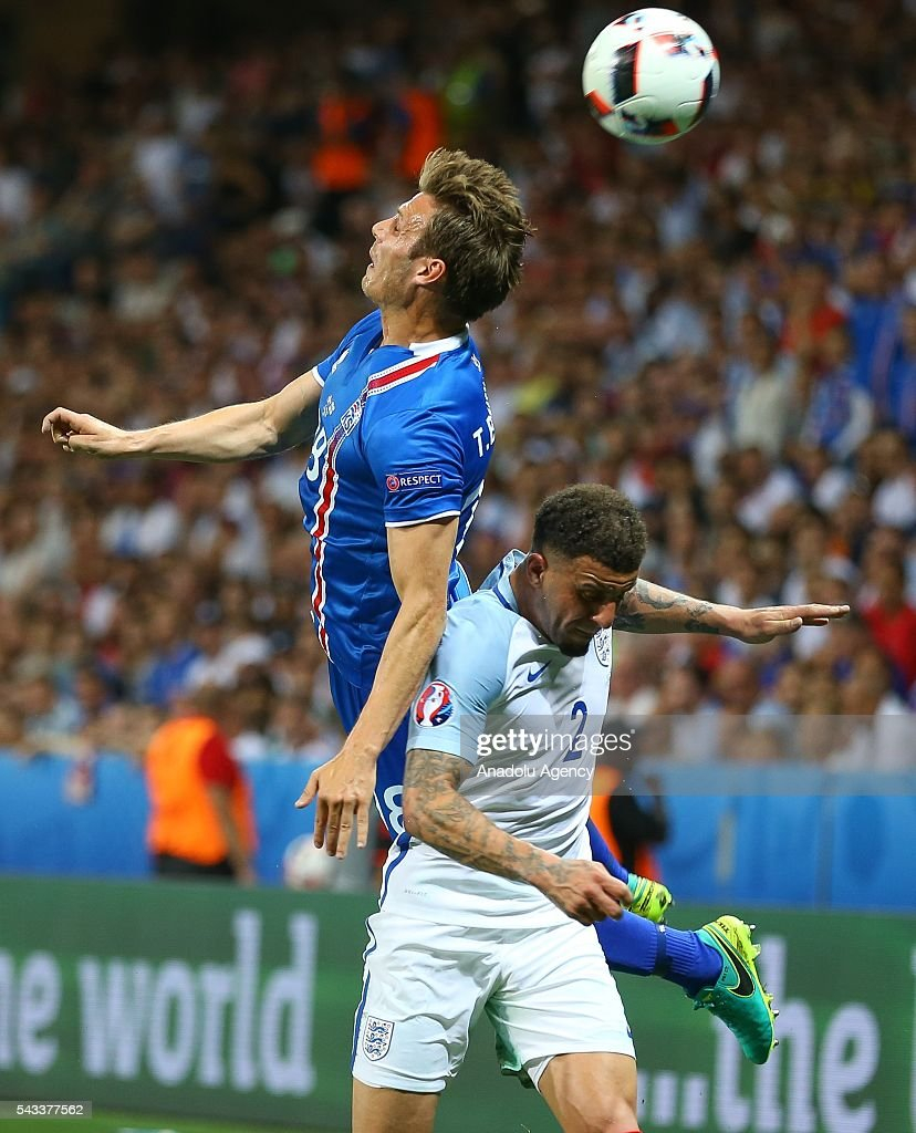 Kyle Walker (2) of England in action against Elmar Bjarnason (18) of Iceland during the UEFA Euro 2016 Round of 16 football match between Iceland and England at Stade de Nice in Nice, France on June 27, 2016.