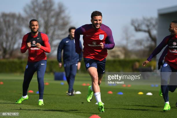 Kyle Walker of England runs through drills with teammates during the England training session at the Tottenham Hotspur Training Centre on March 25...